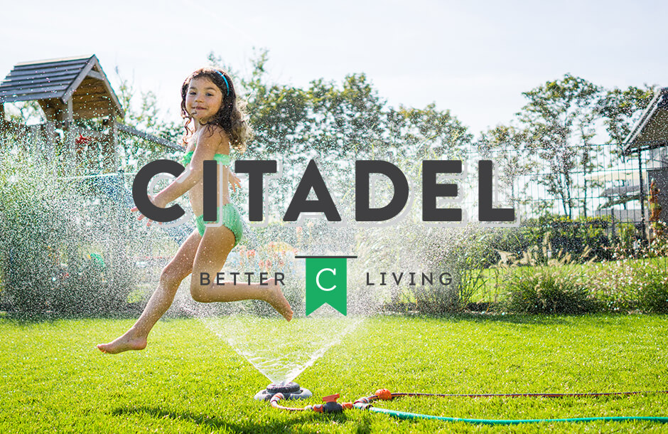 Citadel logo over community landscape