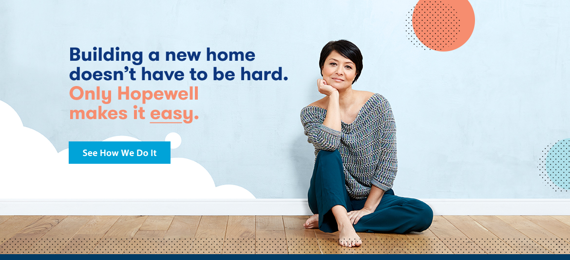 Woman sitting on the floor of her new home