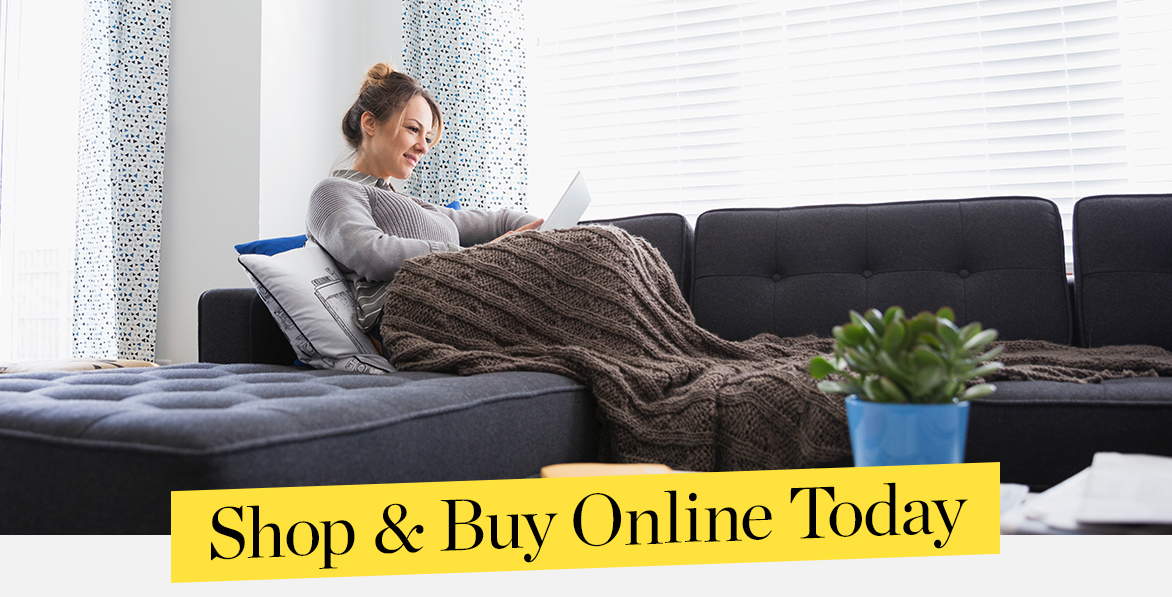Text reads: Shop and Buy Online Today. Image: Mom, Dad and Daughter sitting on a couch browsing on an iPad